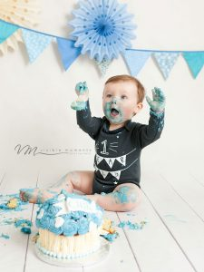 baby boy cake smash happy hands up blue cake