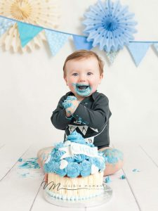 first birthday boy blue cake smash photos