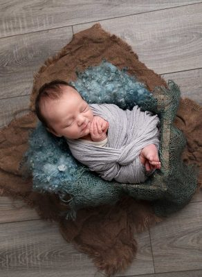 newborn baby in a basket photography studio dublin