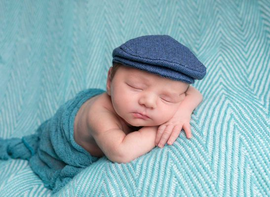 baby boy laying on a blue blanket dublin photographer