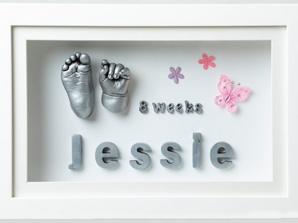 baby keepsake hand and foot cast in the frame